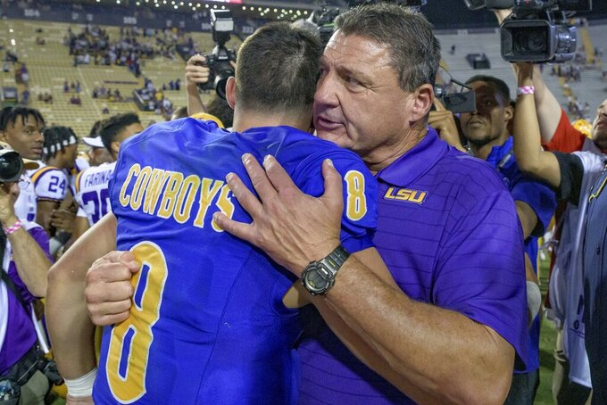 LSU head coach Ed Orgeron hugs his son, McNeese State quarterback Cody Orgeron (8), after LSU's 34-7 victory in an NCAA college football game in Baton Rouge, La., Saturday, Sept. 11, 2021. (AP Photo/Matthew Hinton)