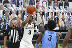 Providence's David Duke (3) shoots over Villanova's Brandon Slater (3) during an NCAA college basketball game in Providence, R.I., Saturday, March 6, 2021. Duke scored the winning basket to beat Villanova, 54-52. (AP Photo/Stew Milne)