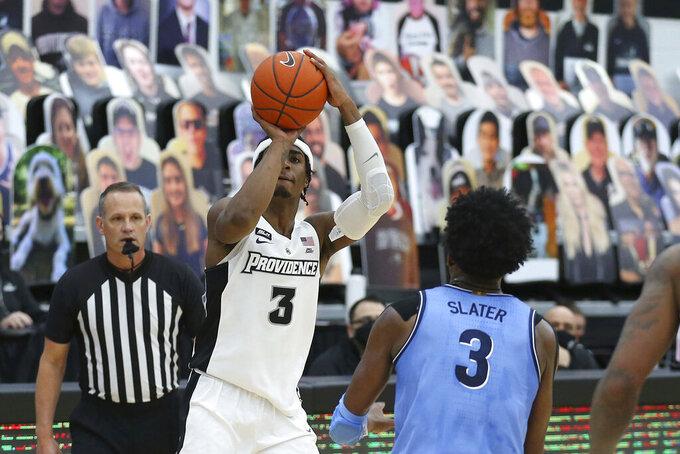 Providence's David Duke (3) shoots over Villanova's Brandon Slater (3) during an NCAA college basketball game in Providence, R.I., Saturday, March 6, 2021. Duke scored the winning basket to beat Villanova, 54-52. (AP Photo/Stew Milne)