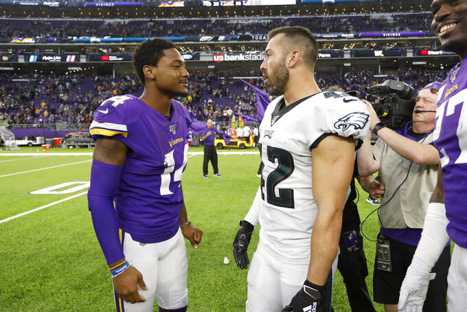 Minnesota Vikings wide receiver Stefon Diggs, left, talks with Philadelphia Eagles strong safety Andrew Sendejo after an NFL football game, Sunday, Oct. 13, 2019, in Minneapolis. (AP Photo/Bruce Kluckhohn)
