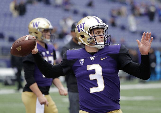 Washington quarterback Jake Browning passes during warmups before an NCAA college football game against Colorado, Saturday, Oct. 20, 2018, in Seattle. (AP Photo/Ted S. Warren)