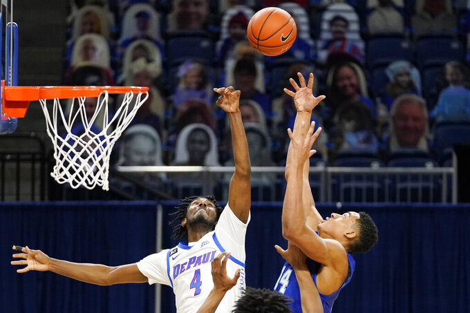 DePaul guard Javon Freeman-Liberty, left, and Seton Hall guard/forward Jared Rhoden battle for a rebound during the second half of an NCAA college basketball game in Chicago, Saturday, Jan. 9, 2021. (AP Photo/Nam Y. Huh)