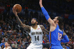 New Orleans Pelicans forward Brandon Ingram (14) goes to the basket past Oklahoma City Thunder center Steven Adams (12) during the second half of an NBA basketball game Friday, Nov. 29, 2019, in Oklahoma City. (AP Photo/Sue Ogrocki)