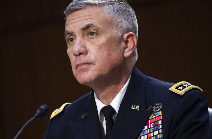"""FILE - In this April 14, 2021, file photo National Security Agency (NSA) Director Gen. Paul Nakasone testifies during a Senate Select Committee on Intelligence hearing about worldwide threats, on Capitol Hill in Washington. Nakasone who leads U.S. efforts to thwart and punish foreign-based cyberattacks says he's mounting a new """"surge"""" to fight incursions that have at times debilitated government agencies and companies responsible for critical infrastructure. In an interview, Nakasone broadly described """"an intense focus"""" by government specialists to better find and share information about cyberattacks and """"impose costs when necessary."""" (Saul Loeb/Pool via AP, File)"""
