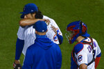 Chicago Cubs starting pitcher Yu Darvish, center, is patted on the back by first baseman Anthony Rizzo, back, after being relieved during the seventh inning of a baseball game against the Minnesota Twins Sunday, Sept. 20, 2020, in Chicago. (AP Photo/Matt Marton)