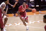 Alabama's Herbert Jones (1) dribbles past Tennessee's Josiah-Jordan James, left, during an NCAA college basketball game Saturday, Jan. 2, 2021, in Knoxville, Tenn. (Caitie McMekin/Knoxville News Sentinel via AP, Pool)
