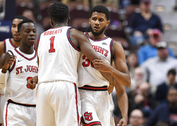 St. John's LJ Figueroa, right, is congratulated by teammate Josh Roberts during the first half of an NCAA college basketball game against Arizona State, Saturday, Nov. 23, 2019, in Uncasville, Conn. (AP Photo/Jessica Hill)