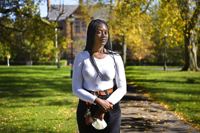Alphina Kamara at Wesleyan University, Saturday, Oct. 17, 2020, in Middletown, Conn. Kamara, a junior at Wesleyan University studying English and sociology, says she was never encouraged to explore options like an engineering course while in high school. (AP Photo/Jessica Hill)