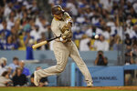 San Diego Padres' Manny Machado flies out to center during the fifth inning of a baseball game against the Los Angeles Dodgers Friday, Sept. 10, 2021, in Los Angeles. (AP Photo/Ashley Landis)