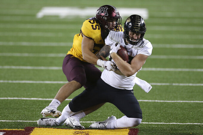 Purdue tight end Payne Durham, right, is tackled by Minnesota linebacker Mariano Sori-Marin (55) during the second half of an NCAA college football game Friday, Nov. 20, 2020, in Minneapolis. Minnesota won 34-31. (AP Photo/Stacy Bengs)