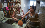 In this Wednesday, Aug. 21, 2019 photo, Vivien Tartter, left, visits with her house guest, Guatemalan immigrant Rosayra Pablo Cruz, in a downstairs apartment Tartter has made available to Cruz and her family, in New York. Tartter was connected to Pablo Cruz by the group Immigrant Families Together. (AP Photo/Bebeto Matthews)