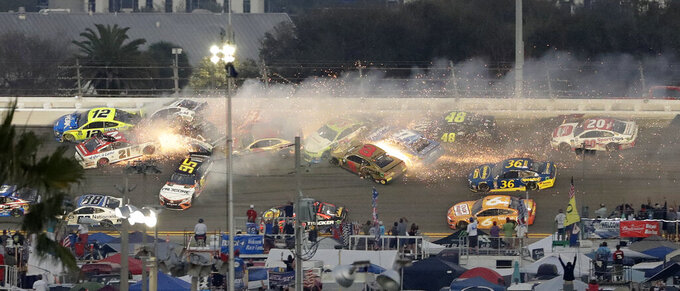 Multiple cars, including Austin Dillon (3), Daniel Suarez (41), David Ragan (38), Paul Menard (21), Ryan Newman (6), Aric Almirola (10), Matt DiBenedetto (95), and Ryan Blaney (12) crash during a NASCAR Daytona 500 auto race Sunday, Feb. 17, 2019, at Daytona International Speedway in Daytona Beach, Fla. (AP Photo/Chris O'Meara)