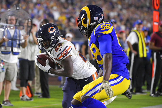 Chicago Bears running back Tarik Cohen scores past Los Angeles Rams inside linebacker Cory Littleton during the second half of an NFL football game Sunday, Nov. 17, 2019, in Los Angeles. (AP Photo/Mark J. Terrill)