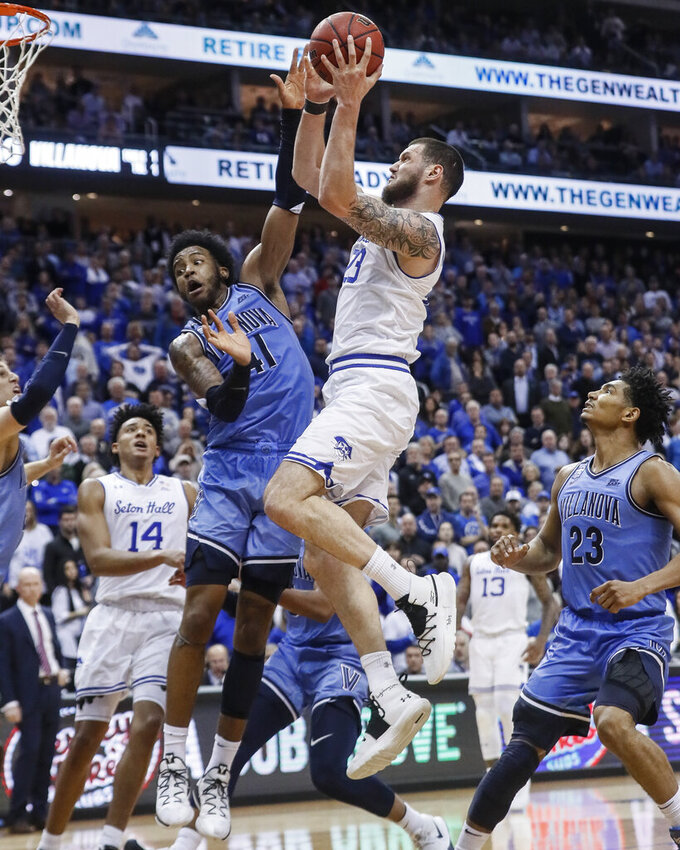 Seton Hall's Sandro Mamukelashvili (23) shoots against Villanova's Saddiq Bey (41) during the second half of an NCAA college basketball game Wednesday, March 4, 2020, in Newark, N.J. (AP Photo/John Minchillo)