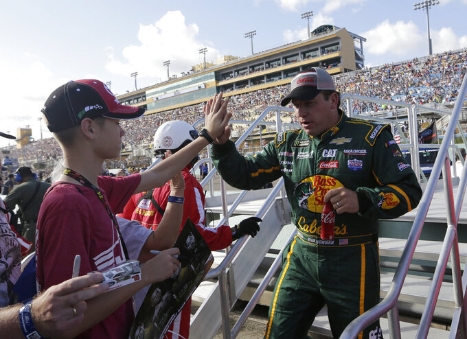 Ryan Newman, right, greets a fan before the NASCAR Series Championship auto race at the Homestead-Miami Speedway, Sunday, Nov. 18, 2018, in Homestead, Fla. (AP Photo/Lynne Sladky)