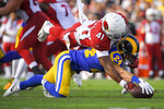 Los Angeles Rams safety Taylor Rapp recovers a fumble against Arizona Cardinals running back Kenyan Drake during first half of an NFL football game Sunday, Dec. 29, 2019, in Los Angeles. (AP Photo/Mark J. Terrill)