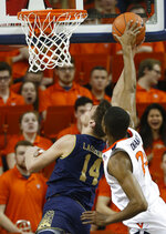 Virginia guard De'Andre Hunter (12) defends a shot by Notre Dame forward Nate Laszewski (14) during the second half of an NCAA college basketball game in Charlottesville, Va., Saturday, Feb. 16, 2019. Virginia beat Notre Dame 60-54. (AP Photo/Steve Helber)