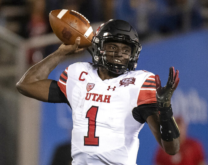 Utah quarterback Tyler Huntley looks to throw a pass during the second half of an NCAA college football game against UCLA Friday, Oct. 26, 2018, in Pasadena, Calif. (AP Photo/Kyusung Gong)
