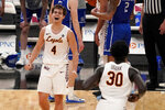 Loyola of Chicago's Braden Norris (4) and teammate Aher Uguak (30) celebrate a 75-65 victory over Drake during the championship game in the NCAA Missouri Valley Conference men's basketball tournament Sunday, March 7, 2021, in St. Louis. (AP Photo/Jeff Roberson)
