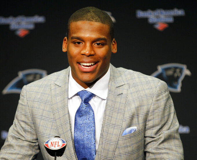 FILE - In this April 29, 2011, file photo, Carolina Panthers first-round draft pick Cam Newton answers a question after being introduced during an NFL football news conference at Bank of America Stadium in Charlotte, N.C. Cam Newton is a former league MVP and the long-time face of the Panthers franchise. But it's hard not to wonder if his future in Carolina is coming to an end following his recent spate of injuries. (AP Photo/Bob Leverone, File)
