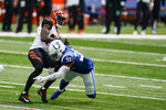 Cincinnati Bengals' A.J. Green, top, is tackled by Indianapolis Colts' Khari Willis (37) during the second half of an NFL football game, Sunday, Oct. 18, 2020, in Indianapolis. (AP Photo/Michael Conroy)
