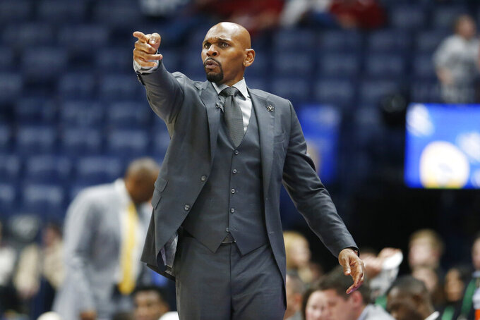Vanderbilt head coach Jerry Stackhouse directs his players in the second half of an NCAA college basketball game against Arkansas in the Southeastern Conference Tournament Wednesday, March 11, 2020, in Nashville, Tenn. Arkansas won 86-73. (AP Photo/Mark Humphrey)