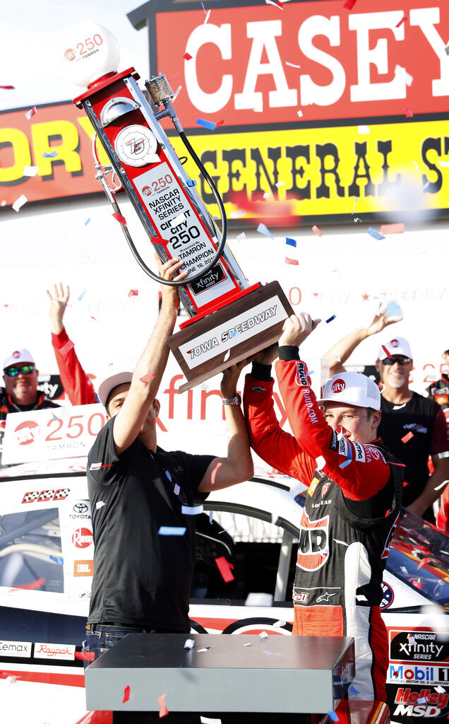 Christopher Bell, right, celebrates in Victory Lane after winning a NASCAR Xfinity Series auto race, Sunday, June 16, 2019, at Iowa Speedway in Newton, Iowa. (AP Photo/Charlie Neibergall)