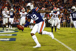 Auburn wide receiver Eli Stove (12) scores a touchdown during the second half of an NCAA college football game against Georgia, Saturday, Nov. 16, 2019, in Auburn, Ala. (AP Photo/Butch Dill)