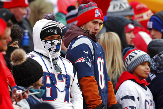 Fans bundle up as they arrive at Arrowhead Stadium before the AFC Championship NFL football game between the Kansas City Chiefs and the New England Patriots, Sunday, Jan. 20, 2019, in Kansas City, Mo. (AP Photo/Charlie Neibergall)