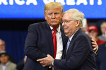 President Donald Trump, left, hugs Senate Majority Leader Mitch McConnell of Ky., right, as he comes up on stage during a campaign rally in Lexington, Ky., Monday, Nov. 4, 2019.  (AP Photo/Susan Walsh)