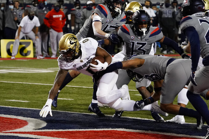 Colorado running back Ashaad Clayton (0) scores a touchdown against Arizona in the first half during an NCAA college football game, Saturday, Dec. 5, 2020, in Tucson, Ariz. (AP Photo/Rick Scuteri)