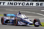 FILE - In this May 15, 2021, file photo, Jimmie Johnson drives through a turn during the IndyCar auto race at Indianapolis Motor Speedway in Indianapolis. Johnson is hopeful of testing in August at Homestead-Miami Speedway as part of a path toward running in the Indianapolis 500 in 2022. The seven-time NASCAR champion jumped this season to IndyCar and has competed in seven races for team owner Chip Ganassi.(AP Photo/Michael Conroy, File)