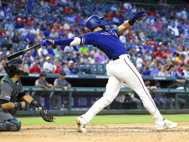 FILE - In this July 16, 2019, file photo, Texas Rangers' Joey Gallo follows through on a solo home run in the fourth inning of a baseball game against the Arizona Diamondbacks in Arlington, Texas. (AP Photo/Richard W. Rodriguez, File)