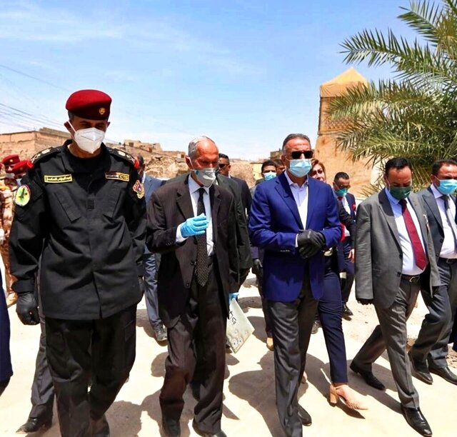 TAKES OUT REFERENCE TO DESIGNATE - Iraqi Prime Minister Mustafa al-Kahdimi, center, visits the site of the Al–Nuri mosque, which was destroyed by Islamic State militants, during his visit to Mosul, Iraq, Wednesday, June 10, 2020. (Iraqi Prime Minister Media Office, via AP)