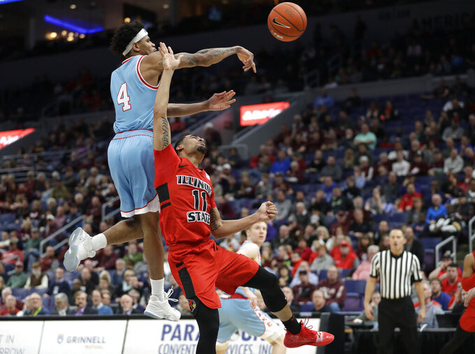 Drake's Anthony Murphy (4) knocks the ball away from Illinois State's Josh Jefferson (11) during the second half of an NCAA college basketball game in the quarterfinal round of the Missouri Valley Conference tournament, Friday, March 8, 2019, in St. Louis. (AP Photo/Jeff Roberson)