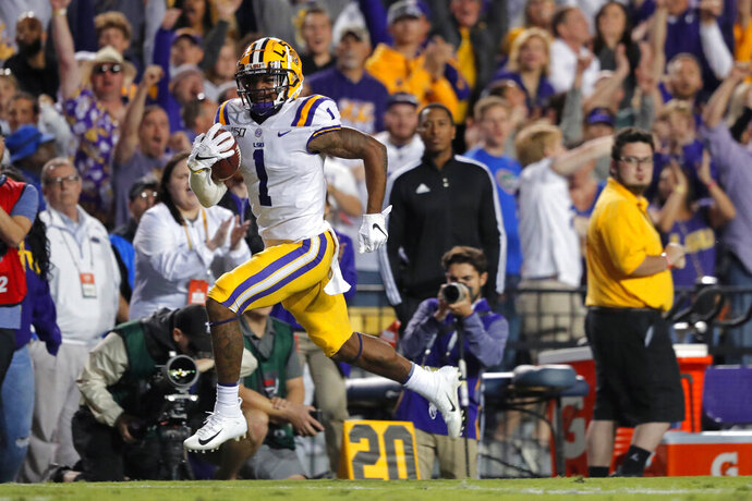 LSU wide receiver Ja'Marr Chase (1) carries on a touchdown reception in the second half of an NCAA college football game against Florida in Baton Rouge, La., Saturday, Oct. 12, 2019. LSU won 42-28. (AP Photo/Gerald Herbert)