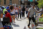 Residents wait in line outside the Wilkinsburg Municipal Building to cast their vote during primary voting, in Pittsburgh, Tuesday, June 2, 2020. (AP Photo/Gene J. Puskar)