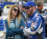 FILE - In this Sunday, Nov. 1, 2015 file photo, Sprint Cup Series driver Dale Earnhardt Jr. (88) talks with his fiance, Amy Reimann, prior to the Sprint Cup auto race at Martinsville Speedway in Martinsville, Va. NASCAR television analyst and former driver Dale Earnhardt Jr. was taken to a hospital after his plane crashed in east Tennessee. (AP Photo/Steve Helber, File)