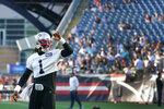 New England Patriots quarterback Cam Newton (1) waves to fans in attendance at Gillette Stadium during the NFL football team's practice Friday, Aug. 6, 2021, in Foxborough, Mass. (AP Photo/Elise Amendola)
