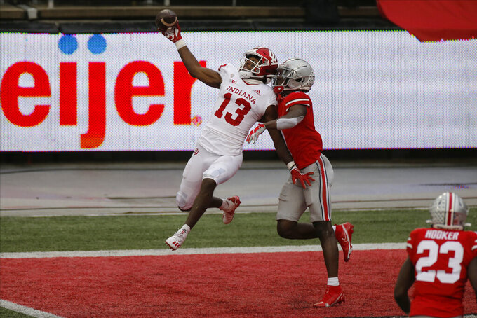 Ohio State defensive back Sevyn Banks, right, breaks up a pass intended for Indiana receiver Miles Marshall during the second half of an NCAA college football game Saturday, Nov. 21, 2020, in Columbus, Ohio. Ohio State beat Indiana 42-35. (AP Photo/Jay LaPrete)