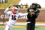Missouri wide receiver Damon Hazelton, right, catches a pass as Georgia defensive back Lewis Cine (16) defends during the second half of an NCAA college football game Saturday, Dec. 12, 2020, in Columbia, Mo. (AP Photo/L.G. Patterson)