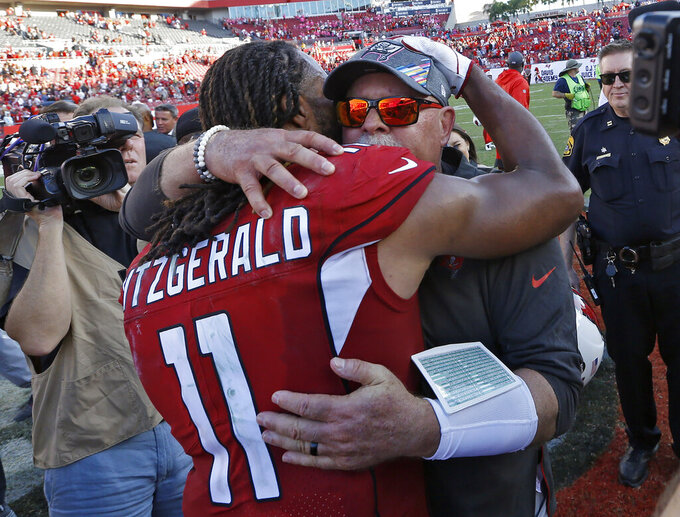 Arizona Cardinals wide receiver Larry Fitzgerald (11) hugs Tampa Bay Buccaneers head coach Bruce Arians after an NFL football game Sunday, Nov. 10, 2019, in Tampa, Fla. Arians is a former Cardinals head coach. (AP Photo/Mark LoMoglio)