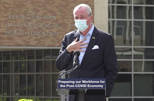 FILE - In this Oct. 21, 2020, file photo, taken from video provided by the New Jersey Governor's Office, New Jerrsey Gov. Phil Murphy tells attendees at an event in Blackwood, N.J., that he must leave the event to quarantine after just finding out that he'd been in contact with someone who had tested positive for COVID-19. Murphy said on Thursday, Oct. 22, 2020, that New Jersey's climbing number of COVID-19 cases are beginning to spread to northern counties around New York. Essex, Union, Hudson and Bergen counties reported more than 100 new cases overnight, Murphy said, eclipsing recent hot spots in Ocean and Monmouth counties. (New Jersey Office of the Governor via AP, File)