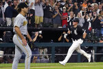 Chicago White Sox's Gavin Sheets, right, heads home after his three-run home run off Pittsburgh Pirates starting pitcher Max Kranick, left, during the fourth inning of a baseball game Wednesday, Sept. 1, 2021, in Chicago. (AP Photo/Charles Rex Arbogast)
