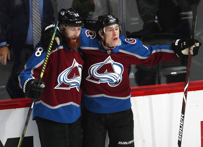 Colorado Avalanche left wing Matt Calvert, right, celebrates his goal with defenseman Ian Cole during the first period of the team's NHL hockey game against the Vegas Golden Knights on Wednesday, March 27, 2019, in Denver. (AP Photo/David Zalubowski)