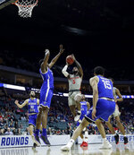 Houston's Corey Davis Jr. (5) puts up a shot during the first half of a first round men's college basketball game against Georgia State in the NCAA Tournament Friday, March 22, 2019, in Tulsa, Okla. (AP Photo/Charlie Riedel)