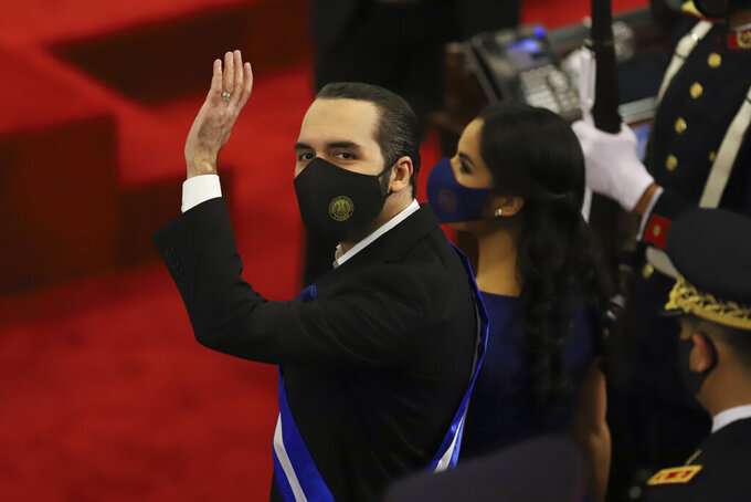 FILE - In this June 1, 2021 file photo, El Salvador's President Nayib Bukele waves during his annual address to the nation before Congress, in San Salvador, El Salvador. El Salvador's top court and its election authority have tossed aside what seemed to be a constitutional ban on consecutive presidential reelection, announced Saturday, Sept. 4, 2021. That sets the stage for Bukele to seek a second term in 2024. (AP Photo/Salvador Melendez, File)