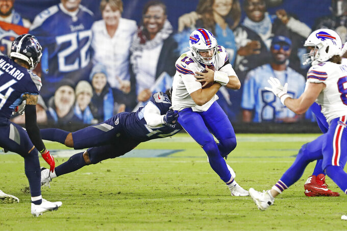 Buffalo Bills quarterback Josh Allen (17) scrambles as Tennessee Titans defensive end Vic Beasley (44) tries to bring him down in the second half of an NFL football game Tuesday, Oct. 13, 2020, in Nashville, Tenn. (AP Photo/Wade Payne)