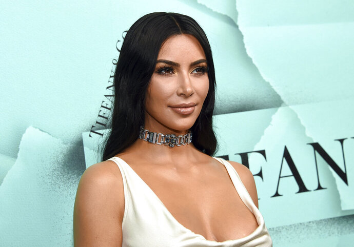 FILE - This Oct. 9, 2018 file photo shows Kim Kardashian West at the Tiffany & Co. 2018 Blue Book Collection: The Four Seasons of Tiffany celebration in New York. Oxygen Media said Tuesday, May 7, 2019, that it has greenlighted a two-hour documentary that will capture Kardashian West's efforts to free prisoners she believes were wrongly accused of crimes.(Photo by Evan Agostini/Invision/AP, File)