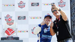 A.J. Allmendinger, left, takes a photo with car owner Matt Kaulig as they celebrate in Victory Lane after winning the B&L Transport 170 NASCAR Xfinity Series auto race at Mid-Ohio Sports Car Course on Saturday, June 5, 2021, in Lexington, Ohio. (AP Photo/Tom E. Puskar)